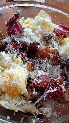 Tasty and Alder famous salad, the Radicchio salad with bacon lardons. manchego. six minute eggs