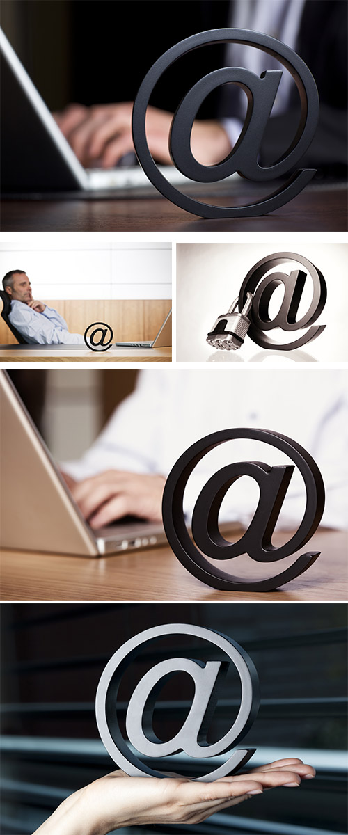 Stock Photo:  At symbol with business person on laptop