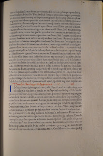A page of printed black text. There are minor blue and red accents.