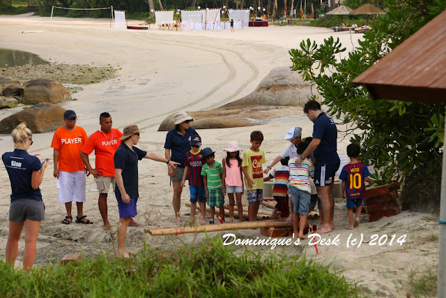 The boys having fun bridge building at Angsana beach