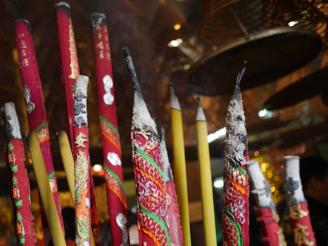 large incense sticks burning in Kwun Yum Temple