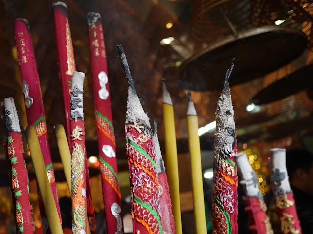 large incense sticks burning in Kwun Yum Temple