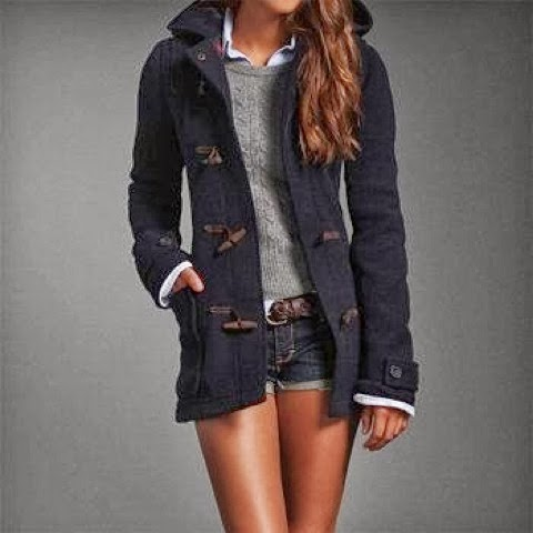 Adorable fall outfit of stylish jacket, grey sweater, mini skirt and white shirt