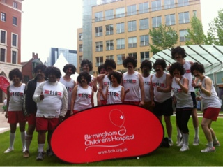 Barclays team dressed as 118 118 characters for Birmingham dragon boat race