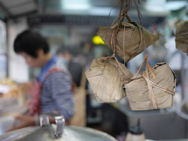 three zongzi (粽子) hanging at a Hong Kong take out restaurant