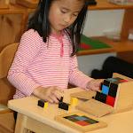 Montessori preschool girl in Irvine working with binomial cube.