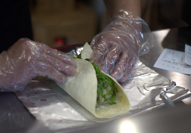 A burrito being made