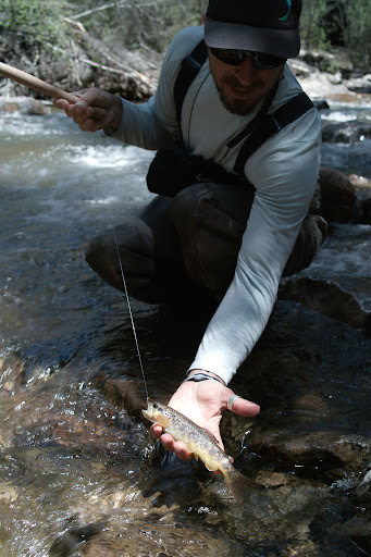 Holding a trout from below