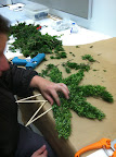 Making our greenery stars.  Marcie is working with Juniper- love the berries.