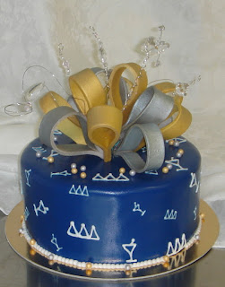 Custom blue, gold and silver delta, delta, delta fondant birthday cake with sugar bow and crystals