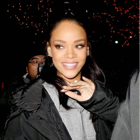 Rihanna in PUMA Evolution Sweatshirt, Married to the Mob Bitch Socks