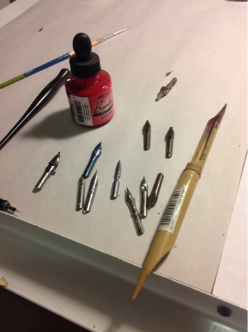 pen nibs, ink, and bamboo stylus