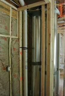 Picture of main return duct and a radon ventilation pipe.
