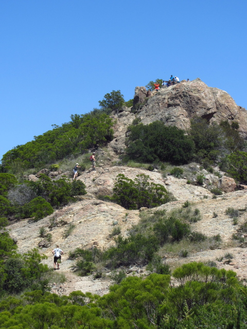 geeks climbing to an already well populated peak