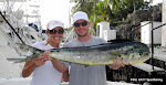 Christie and David Blauvelt visiting from Avon, Ohio proudly showing off their Mahi Mahi October 17, 2011