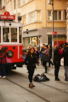 Girl posing in front of tram on Istiklal Street - Istanbul