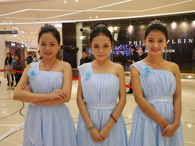 three young women wearing dresses