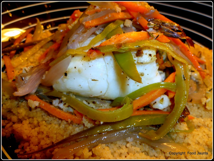 Image of Halibut and Vegetables served over Garlic Couscous