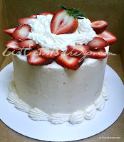 Fourth of July fresh strawberry topped cake 6 inch 2 layer serves 8 - $19 or 8 inch 2 layer serves 10-14 - $27