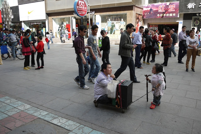 two people with physical disabilities on a pedestrian street in Yinchuan, China