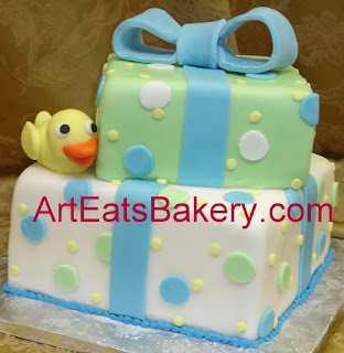 Two tier green, blue and white square custom fondant baby shower cake with yellow duck and polka dots