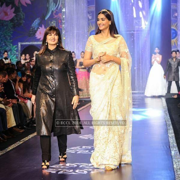 Neeta Lulla with Sonam Kapoor walks the ramp for the finale of India International Jewellery Week (IIJW), 2014, held at Grand Hyatt, in Mumbai.