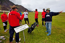 Ken Read getting instructions on why NOT to hit cows with golf balls on Tristan da Cunha- they get mad!