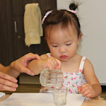 At LePort Schools Parent & Child Montessori even infants learn life skills such as pouring.