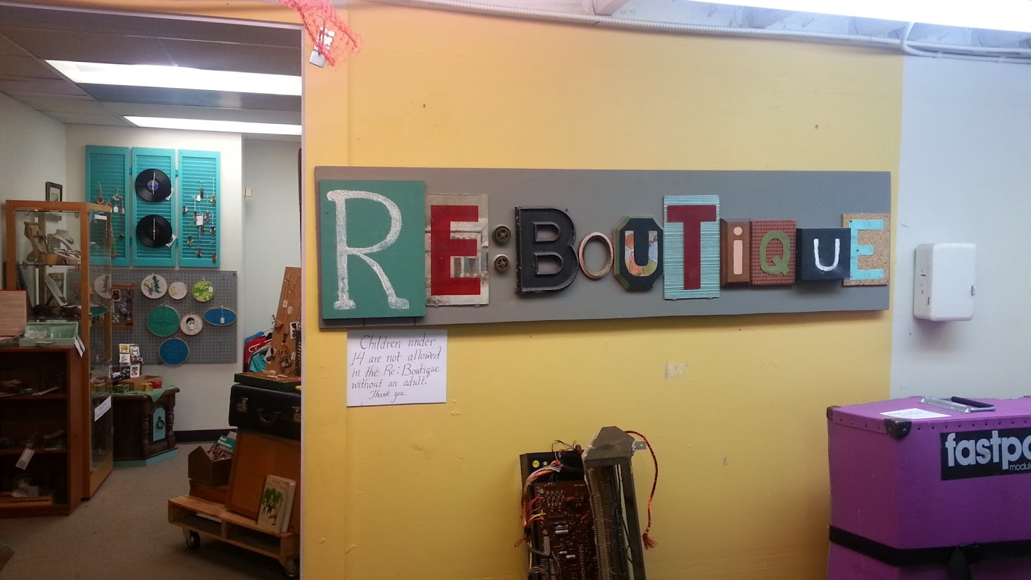 Sign reading Re-Boutique at the entrance to the craft shop at Scrap