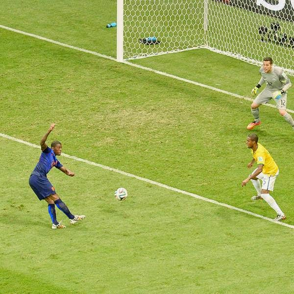 Netherlands' midfielder Georginio Wijnaldum (3L) strikes the ball to score a goal during the third place play-off football match between Brazil and Netherlands during the 2014 FIFA World Cup at the National Stadium in Brasilia on July 12, 2014.