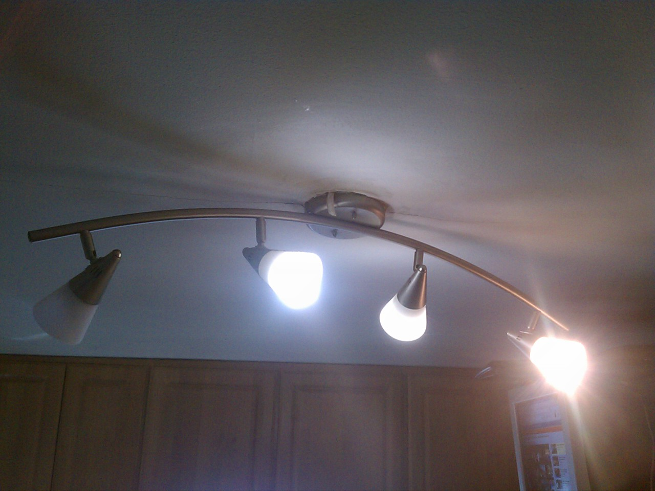 I replaced the light fixture in the kitchen & dining room with a florescent fixture….