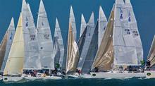 J/105 sailboats- starting on San Francisco Bay sailing in big breeze