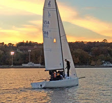 J/70 sailing on Thames River in front of US Coast Guard Academy