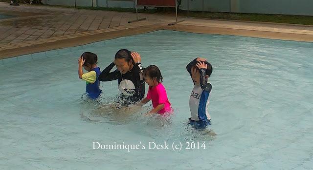the kids having fun in the pool