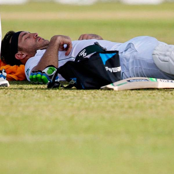 South Africa's Faf du Plessis lies on the ground during the first day of their first test cricket match against Sri Lanka in Galle July 16, 2014.