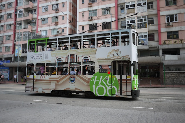 Tram in Hong Kong with Hong Kong University advertising