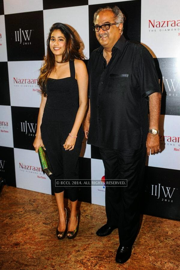 Boney Kapoor with his daughter Jhanvi on Day 3 of India International Jewellery Week (IIJW), 2014, held at Grand Hyatt, in Mumbai.<br />