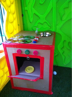 Cardboard kitchen with oven and stove
