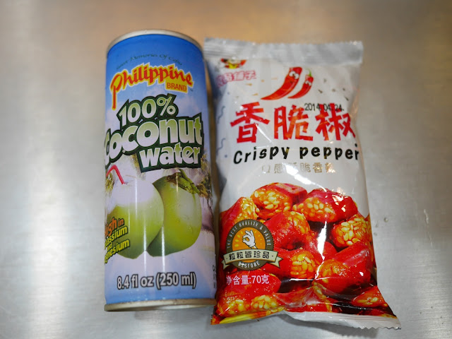 Can of Philippine Brand 100% Coconut water and bag of Chonqing crips peppers