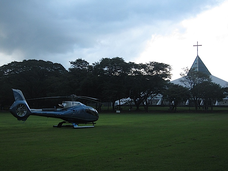 blue helicopter in front of the Ateneo Church of the Gesù