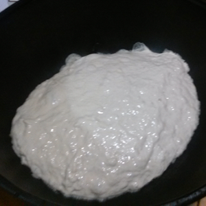 dough plopped into cast-iron Dutch oven