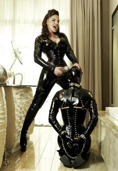 latex mistress in thigh high boots