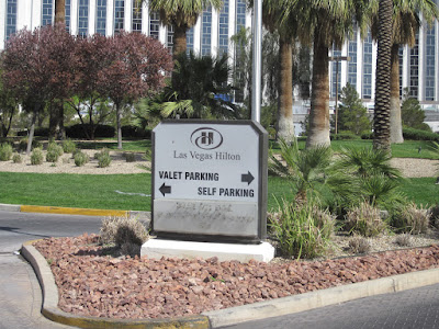 las vegas hilton front sign palm trees stock photo