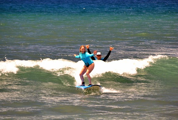 Colleen Lanin surfing in Maui
