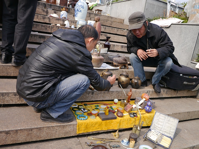 seller at an outdoor antique market in Changsha, China