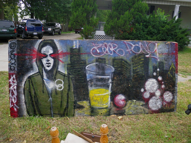 Painting in trash on Normal avenue in Normal, Illinois