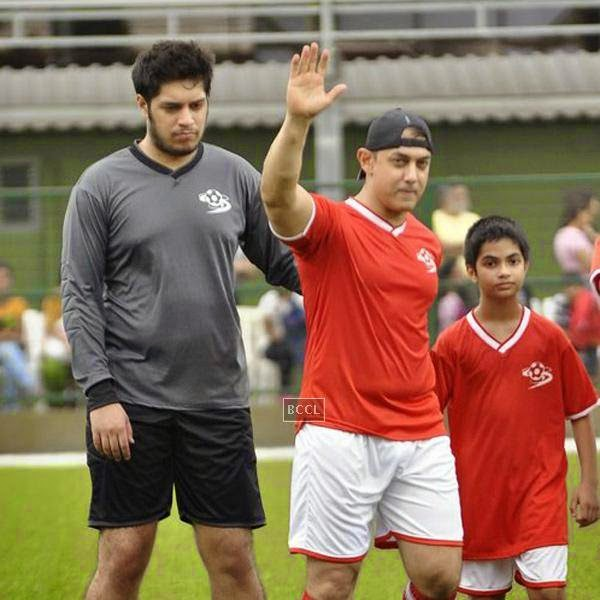 Aamir Khan with his son Junaid (L) during a charity soccer match organised by Aamir's daughter Ira Khan, at Cooperage ground, on July 20, 2014.(Pic: Viral Bhayani)