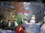 Here are some pics I took of Saks Fifth Avenue's Christmas window displays - in the reflection you can see the tree from Saks