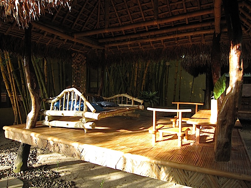 small nipa hut with a bamboo daybed at Ugu Bigyan Potter's Garden