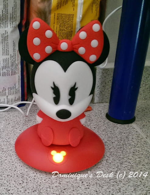 Minnie Mouse being charged on it charger base